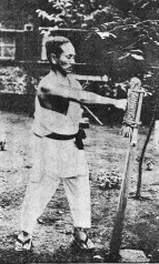 Funakoshi Sensei getting serious with a Makiwara.